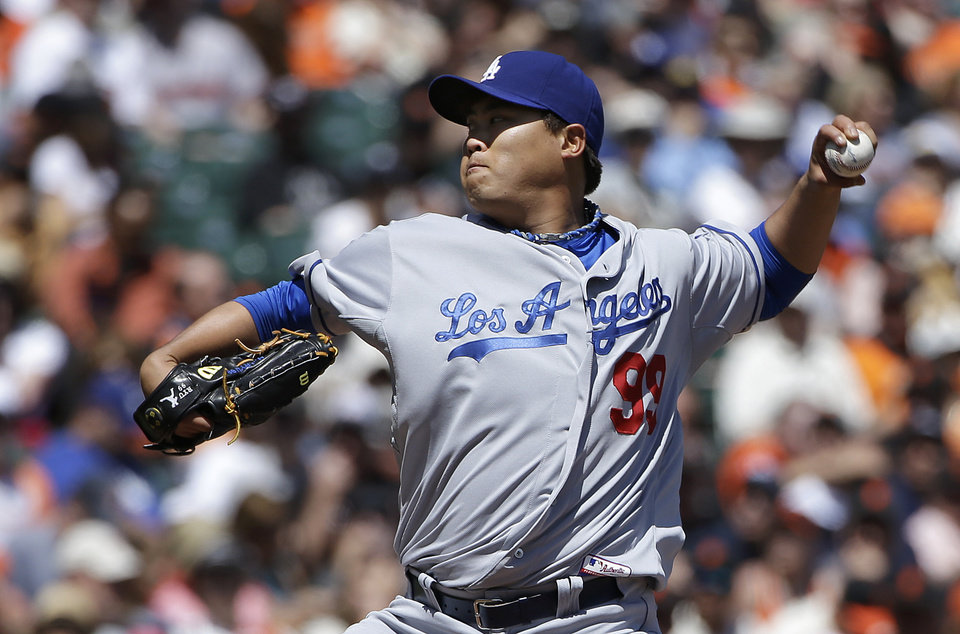 Photo - Los Angeles Dodgers pitcher Hyun-Jin Ryu (99), from South Korea, throws against the San Francisco Giants during the second inning of a baseball game in San Francisco, Thursday, April 17, 2014. (AP Photo/Jeff Chiu)
