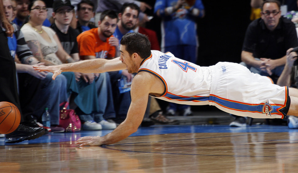 Photo - Oklahoma City's Nick Collison (4) chases a loose ball during the NBA basketball game between the Oklahoma City Thunder and the Golden State Warriors at the Chesapeake Energy Arena in Oklahoma City, Friday, Feb. 17, 2012. Photo by Nate Billings, The Oklahoman