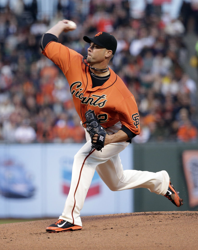 Photo - San Francisco Giants starting pitcher Ryan Vogelsong throws to the Milwaukee Brewers during the first inning of a baseball game on Friday, Aug. 29, 2014, in San Francisco. (AP Photo/Marcio Jose Sanchez)