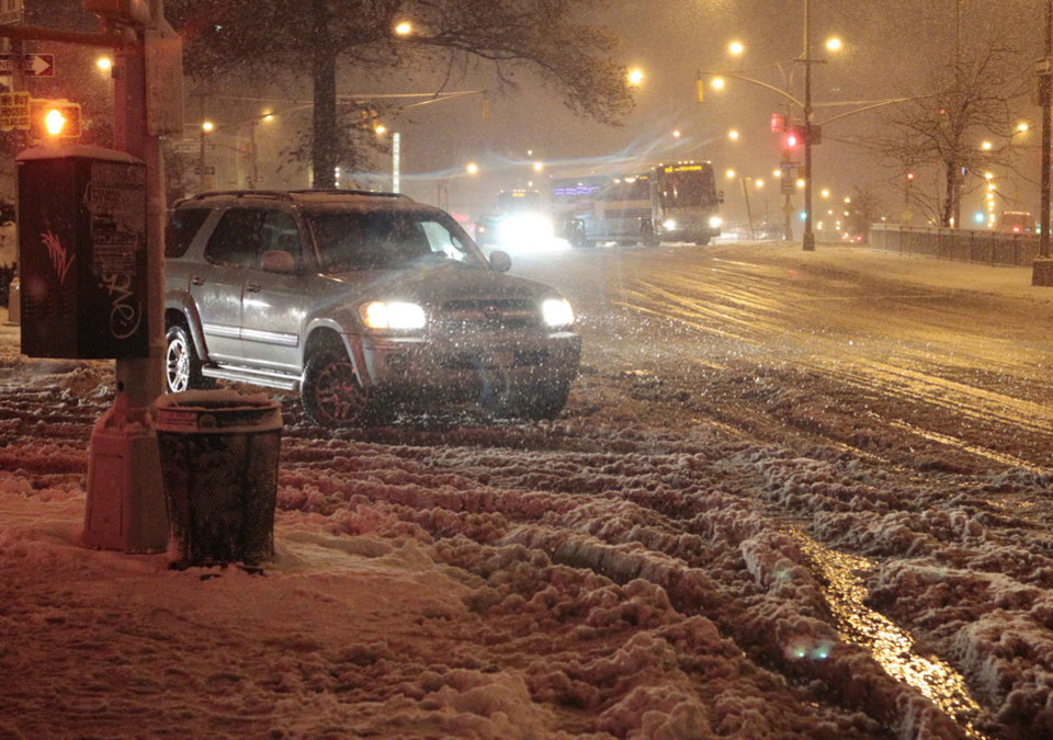 Photo -   Cars navigate Queens Boulevard during a snow storm Wednesday, Nov. 7, 2012, in the Queens borough of New York. Coastal residents of New York and New Jersey faced new warnings to evacuate their homes and airlines canceled hundreds of flights as a new storm arrived Wednesday, only a week after Superstorm Sandy left dozens dead and millions without power. (AP Photo/Frank Franklin II)