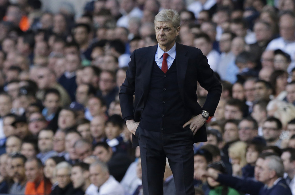 Photo - Arsenal's manager Arsene Wenger watches his team play from the technical area during the English Premier League soccer match between Tottenham Hotspur and Arsenal at White Hart Lane stadium in London, Sunday, March 16, 2014. (AP Photo/Matt Dunham)