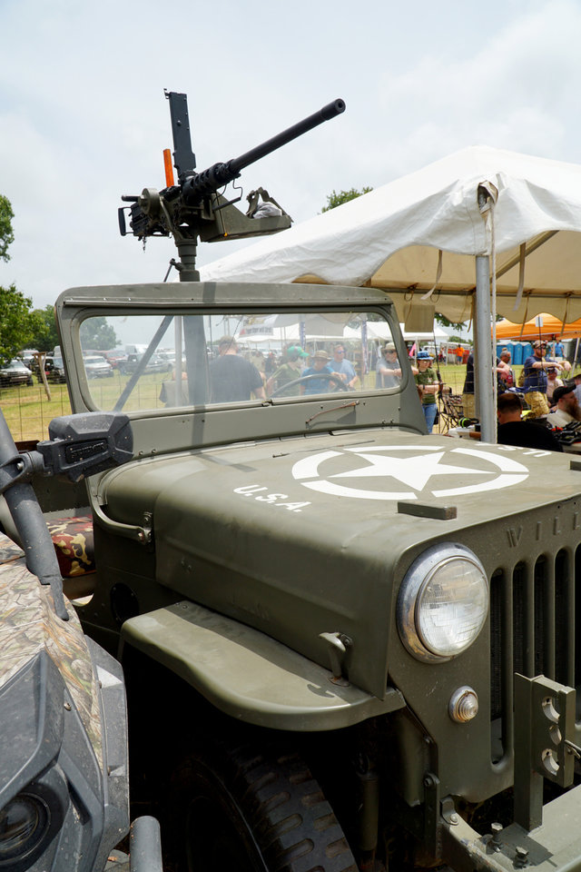 Photo - A vintage military JEEP with a machine gun mounted in the back was at the Oklahoma Full Auto Shoot and Trade Show Saturday in Wyandotte. [Jordan Green/The Oklahoman]