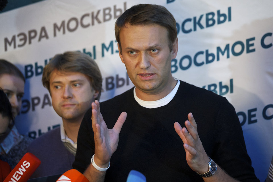 Photo - Russian opposition leader Alexei Navalny speaks to the media at his headquarters in Moscow, Russia, Sunday, Sept. 8, 2013.Two exit polls in Moscow's mayoral election are predicting a stronger showing than expected for opposition leader Alexei Navalny. Sunday's mayoral election is a potentially pivotal contest that has energized the small opposition in ways that could pose a risk to the Kremlin in the days and years ahead. (AP Photo/Alexander Zemlianichenko)
