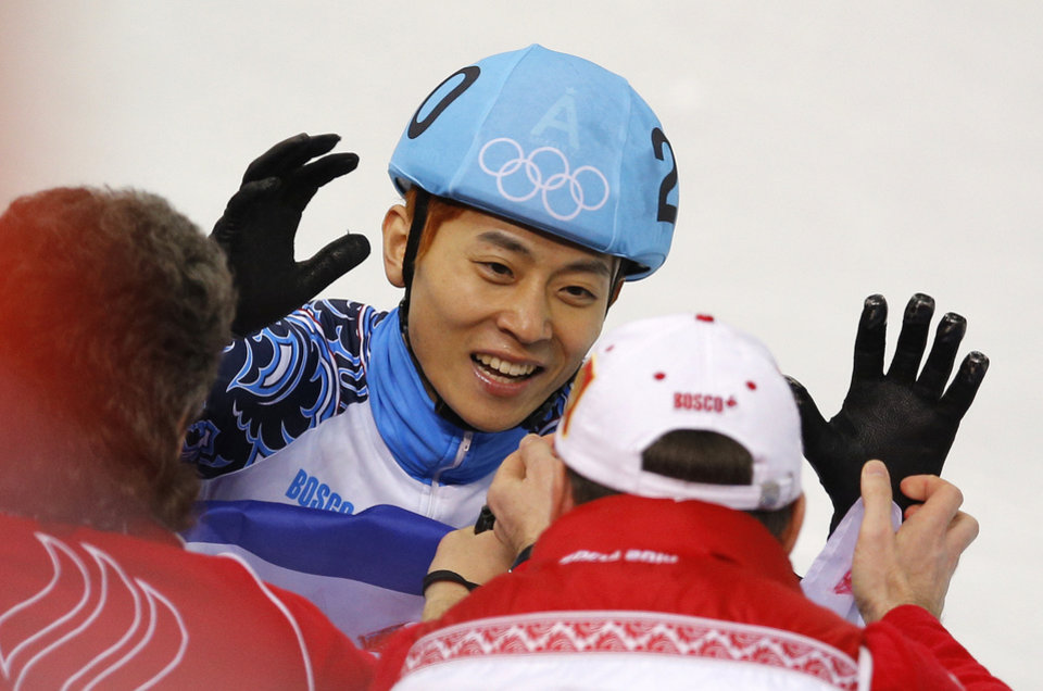 Photo - Victor An of Russia, centre, celebrates with team members after he finished first in the men's 500m short track speedskating final at the Iceberg Skating Palace during the 2014 Winter Olympics, Friday, Feb. 21, 2014, in Sochi, Russia. (AP Photo/Vadim Ghirda)