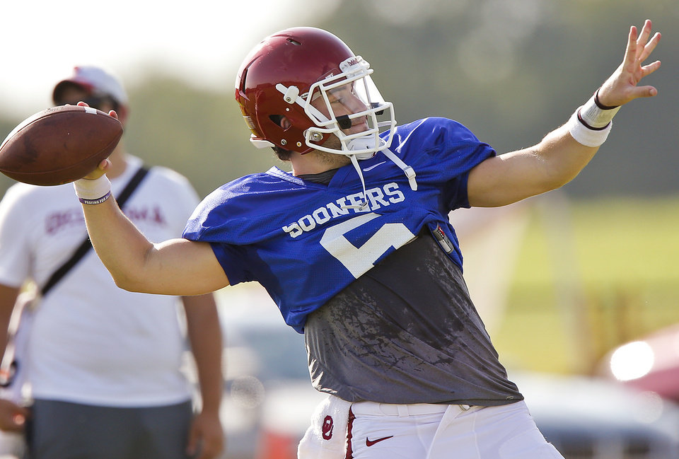 Photo - University of Oklahoma's Baker Mayfield (6) looks to throw a pass during team practice at OU on Monday, Aug. 10, 2015, in Norman, Okla. Photo by Chris Landsberger, The Oklahoman