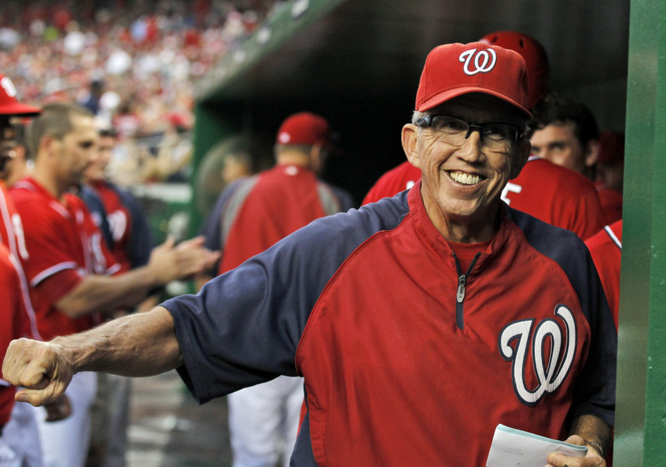 Photo -   FILE - In this Sept. 1, 2012,, file photo, Washington Nationals manager Davey Johnson smiles in the dugout during a baseball game against the St. Louis Cardinals at Nationals Park in Washington. Johnson was voted as the National League Manager of the Year on Tuesday, Nov. 13, 2012. (AP Photo/Alex Brandon, File)