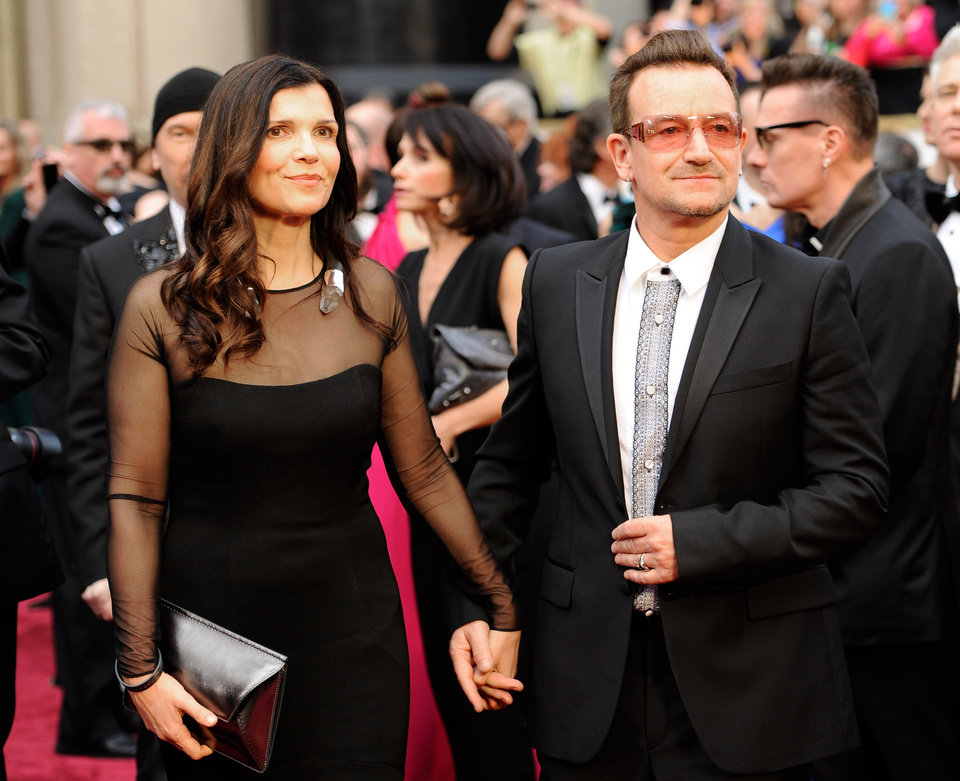 Photo - Ali Hewson, left, and Bono arrive at the Oscars on Sunday, March 2, 2014, at the Dolby Theatre in Los Angeles.  (Photo by Chris Pizzello/Invision/AP)