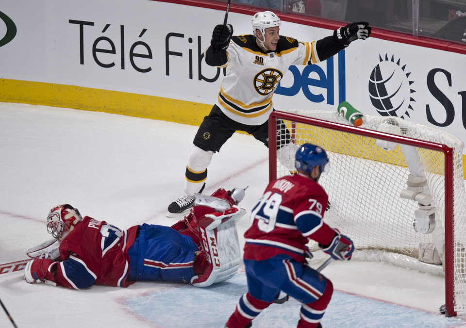 Photo - Boston Bruins' Gregory Campbell celebrates his goal past Montreal Canadiens goalie Carey Price as Canadiens's Andrei Markov look on during first period NHL hockey action Thursday, Dec. 5, 2013, in Montreal. (AP Photo/The Canadian Press, Paul Chiasson)