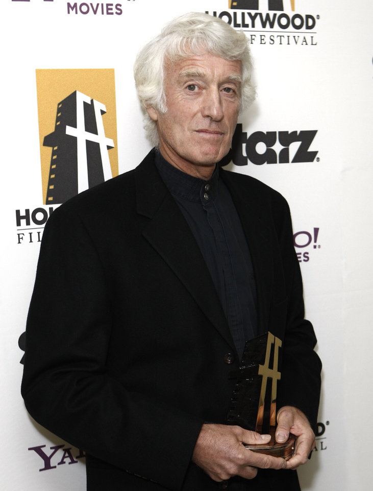 Photo -   FILE - In this Oct. 26, 2009 file photo, Roger Deakins poses with his award for best cinematographer backstage at the 13th Annual Hollywood Awards Gala, in Beverly Hills, Calif. (AP Photo/Matt Sayles, File)