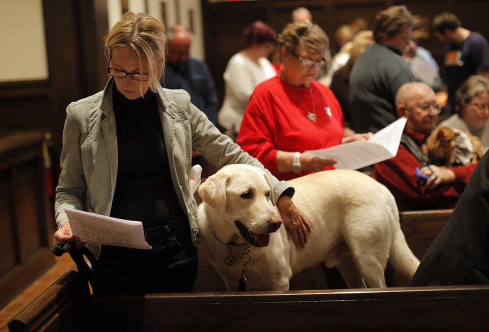 Tracey Burton prays with Watson during a service in Celebration of God's Creations with the Blessing of the Animals at St. Augustine of Canterbury Episcopal Church in Oklahoma City. Sunday, Oct. 7, 2012. Photo by Sarah Phipps, The Oklahoman