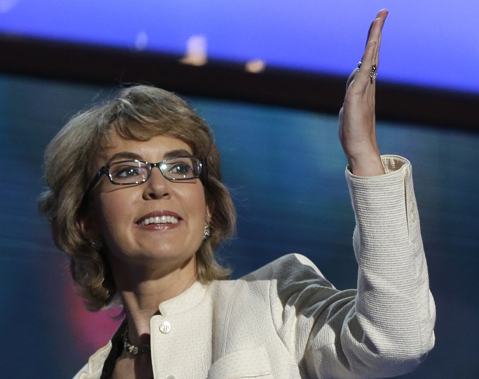 FILE - In this Sept. 6, 2012 file photo, former Arizona Rep. Gabrielle Giffords blows a kiss after reciting the Pledge of Allegiance at the Democratic National Convention in Charlotte, N.C. Giffords and her husband launched a political action committee aimed at curbing gun violence on Tuesday, Jan. 8, 2013, the second anniversary of the Tucson shooting that killed six people and left her critically injured. (AP Photo/Charles Dharapak, File)