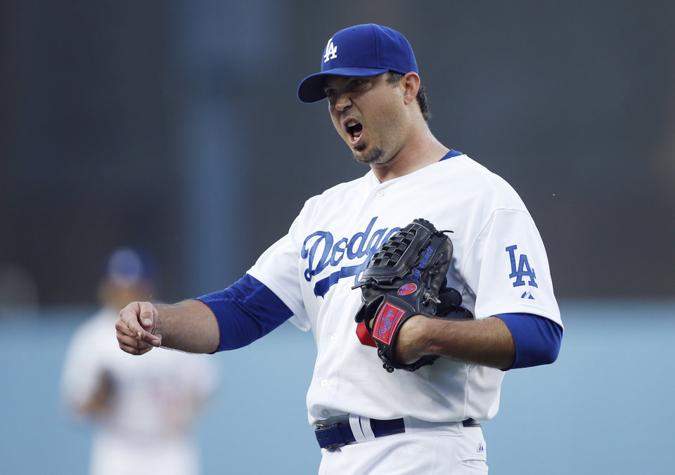 Photo - Los Angeles Dodgers starting pitcher Josh Beckett react as he comes off the field following the top of the first inning of a baseball game against the St. Louis Cardinals, Thursday, June 26, 2014, in Los Angeles. (AP Photo/Danny Moloshok)
