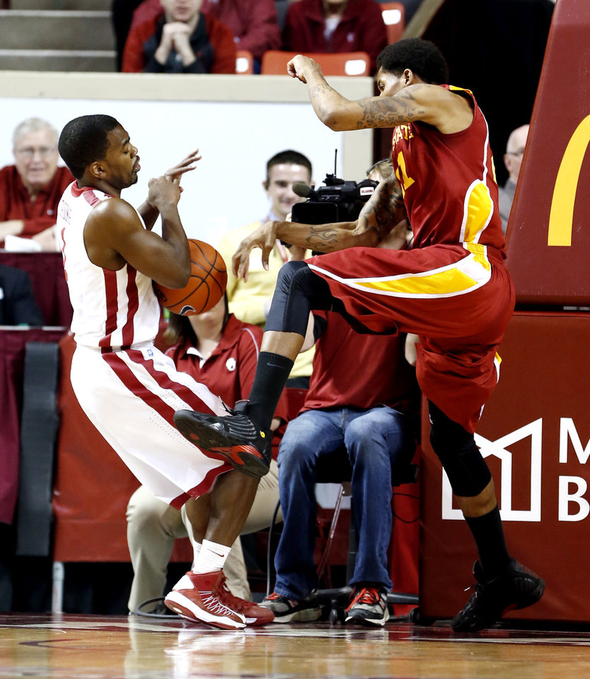 Photo - Iowa State's Will Clyburn (21) tries to bounce the ball off of Oklahoma Sooner's Sam Grooms (1) to save it from going out of bounds as the University of Oklahoma Sooners (OU) men play the Iowa State Cyclones in NCAA, college basketball at Lloyd Noble Center on Saturday, March 2, 2013  in Norman, Okla.  Clyburn was ruled out of bounds and the Sooners were awarded the ball.  Photo by Steve Sisney, The Oklahoman