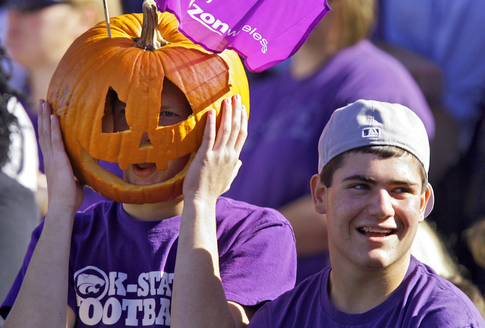 Photo - Kansas State fans enjoy the game against Oklahoma State during the first half of the college football game between the Oklahoma State University Cowboys (OSU) and the Kansas State University Wildcats (KSU) on Saturday, Oct. 30, 2010, in Manhattan, Kan.   Photo by Chris Landsberger, The Oklahoman