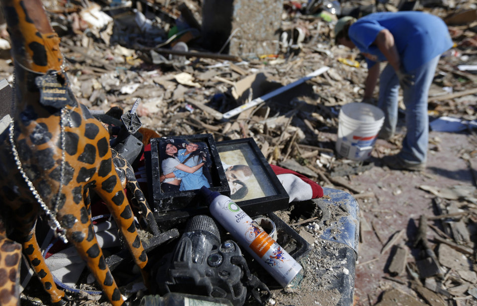 Photo - Vickie Brewer collects valuables from the home of her boyfriend Kevin Jump in the Plaza Towers neighborhood in Moore, Okla., on Wednesday, May 22, 2013. The home was destroyed by a tornado that struck the area on Monday, May 20, 2013. Photo by Bryan Terry, The Oklahoman