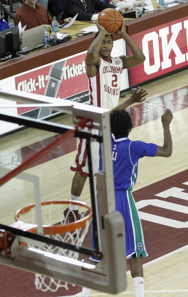 Photo - OU: Oklahoma's Steven Pledger (2) shoots over Texas A&M's Hameed Ali (1) during a college basketball game between the University of Oklahoma and Texas A&M Corpus Christi at McCasland Field House in Norman, Okla., Monday, Dec. 31, 2012.  Photo by Garett Fisbeck, For The Oklahoman