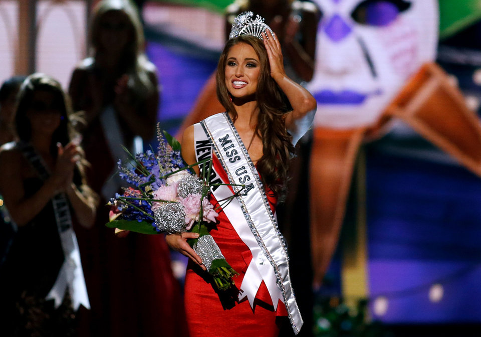 Photo - Miss Nevada USA Nia Sanchez adjusts her crown after  being crowned the new Miss USA during the Miss USA 2014 pageant in Baton Rouge, La., Sunday, June 8, 2014. (AP Photo/Jonathan Bachman)