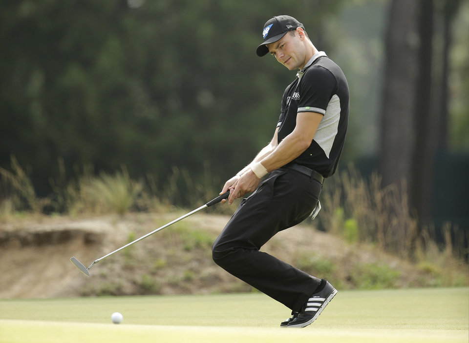 Photo - Martin Kaymer, of Germany, reacts to his missed birdie on the 17th hole during the second round of the U.S. Open golf tournament in Pinehurst, N.C., Friday, June 13, 2014. (AP Photo/Chuck Burton)