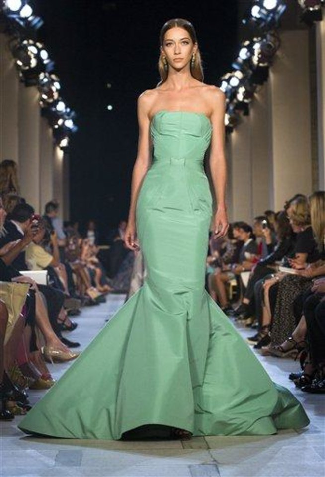 Photo - FILE - This Sept. 9, 2012 file photo shows a dress from the Zac Posen Spring 2013 collection during Fashion Week in New York. The rich, vibrant shade of emerald green is Pantone LLC's Color of the Year for 2013, beating out all the other shades of the rainbow. (AP Photo/John Minchillo, file)