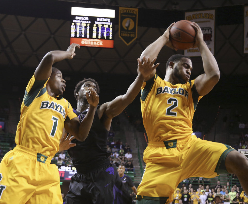 Photo - Baylor forward Rico Gathers (2), right, pulls down a rebound over Kansas State forward Nino Williams (11), center, and Baylor guard Kenny Chery, left, during the first half of an NCAA college basketball game, Saturday, Feb. 15, 2014, in Waco, Texas. (AP Photo/Waco Tribune Herald, Rod Aydelotte)