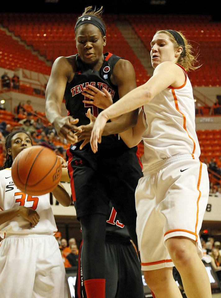 Oklahoma State's Liz Donohoe (4) and Christine Hyde (5) battle for the ball during a women's college basketball game between Oklahoma State University (OSU) and Texas Tech at Gallagher-Iba Arena in Stillwater, Okla., Wednesday, Jan. 2, 2013. Photo by Nate Billings, The Oklahoman