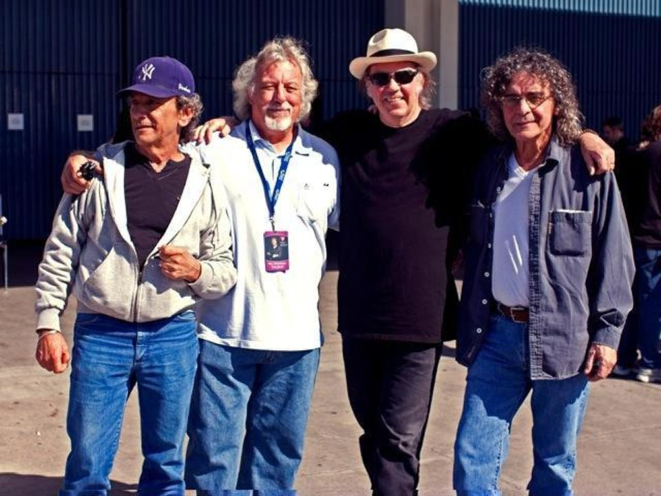 Photo - Neil Young and Crazy Horse are, from left,  Ralph Molina (drums) , Poncho Sampedro (guitars), Young, and Billy Talbot (bass). PHOTO BY JULIE GARDNER