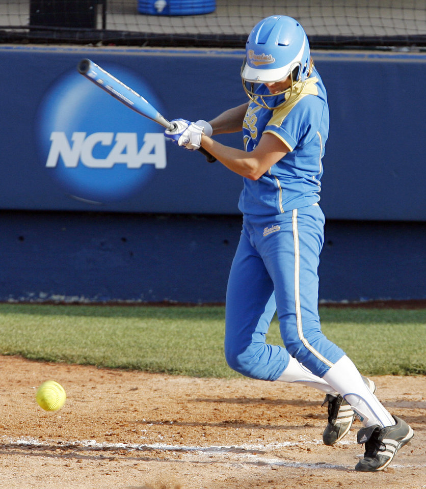 Photo - UCLA's Ashley Herrera (11) slaps a single in the third inning during the softball game in the Women's College World Series between UCLA and Florida at ASA Hall of Fame Stadium in Oklahoma City, Saturday, May 31, 2008. BY NATE BILLINGS, THE OKLAHOMAN