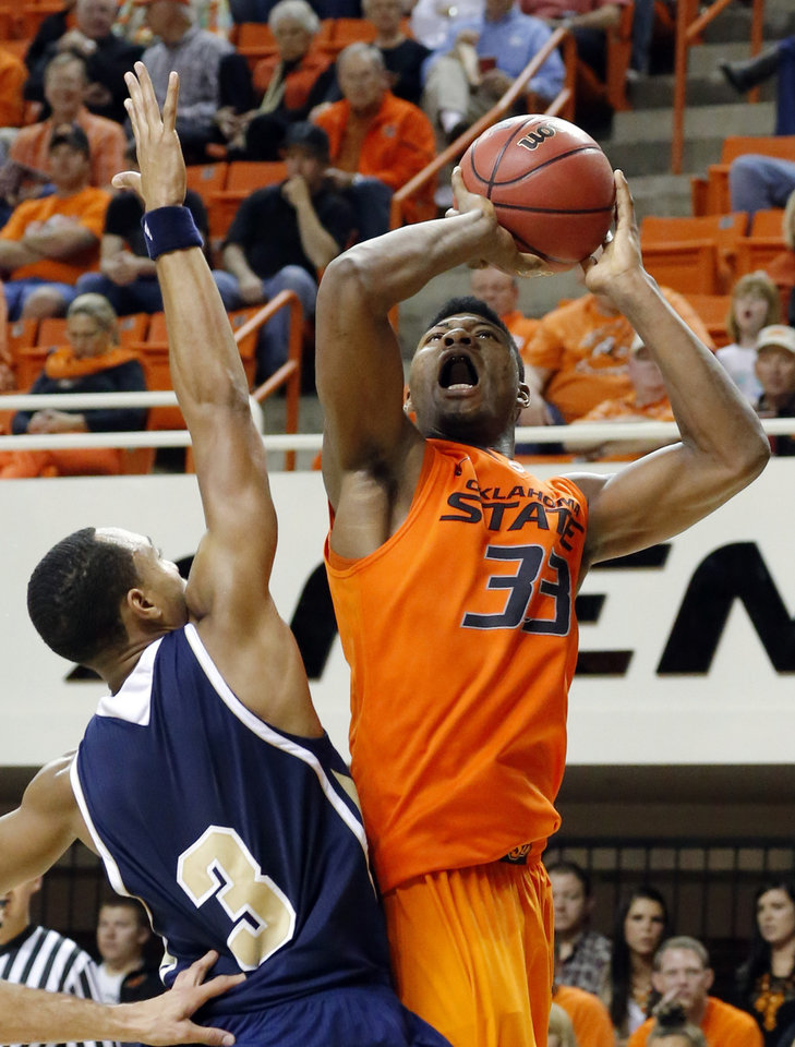 Oklahoma State's Marcus Smart (33) shoots over UC Davis' Corey Hawkins (3) during the men's college basketball game between Oklahoma State and UC Davis at  Gallagher-Iba Arena in Stillwater, Okla., Friday, Nov. 9, 2012. Photo by Sarah Phipps, The Oklahoman