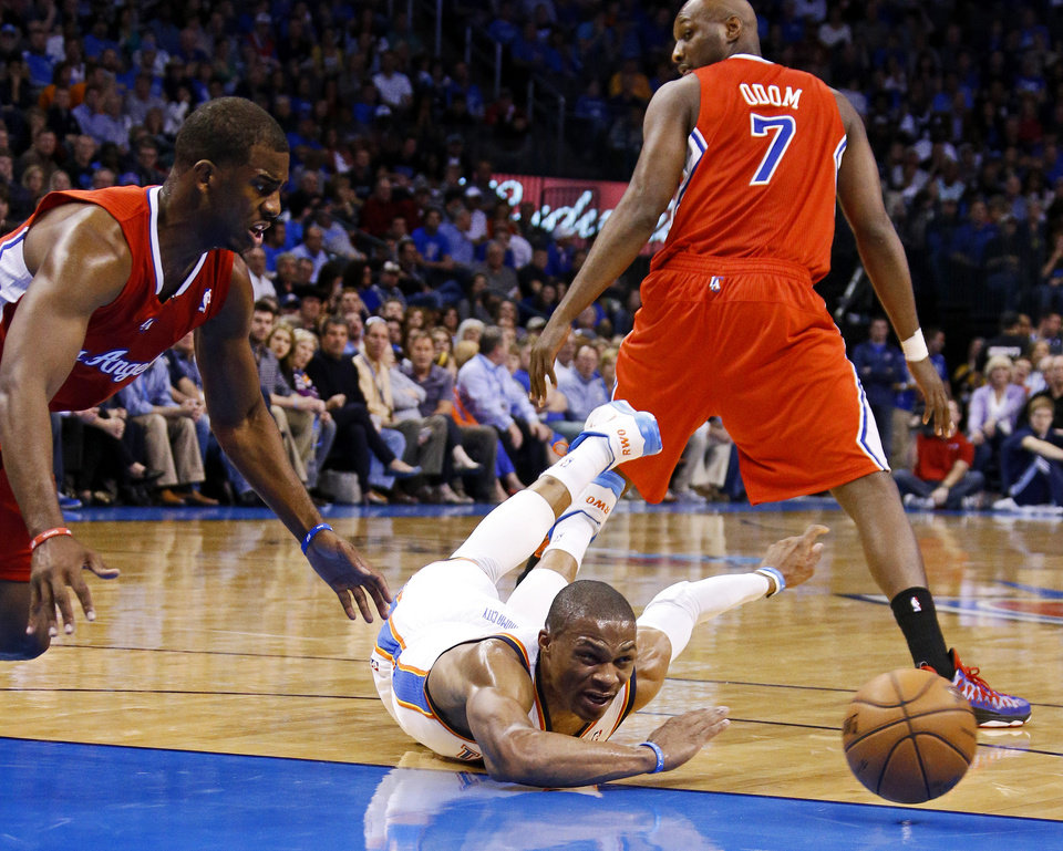 Oklahoma City's Russell Westbrook (0) dives for the ball beside the Clippers Chris Paul (3) during an NBA basketball game between the Oklahoma City Thunder and the Los Angeles Clippers at Chesapeake Energy Arena in Oklahoma City, Wednesday, Nov. 21, 2012. Photo by Bryan Terry, The Oklahoman
