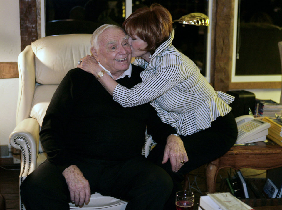 Photo - Actor Ernest Borgnine, left, receives a kiss from Tova, his wife, moments after discovering he didn't win a Golden Globe Sunday, Jan. 13, 2008, in Beverly Hills, Calif. Borgnine was eligible for Golden Globe's best performance by an actor in a mini-series or motion picture made for television. (AP Photo/Ric Francis) ORG XMIT: CARF101