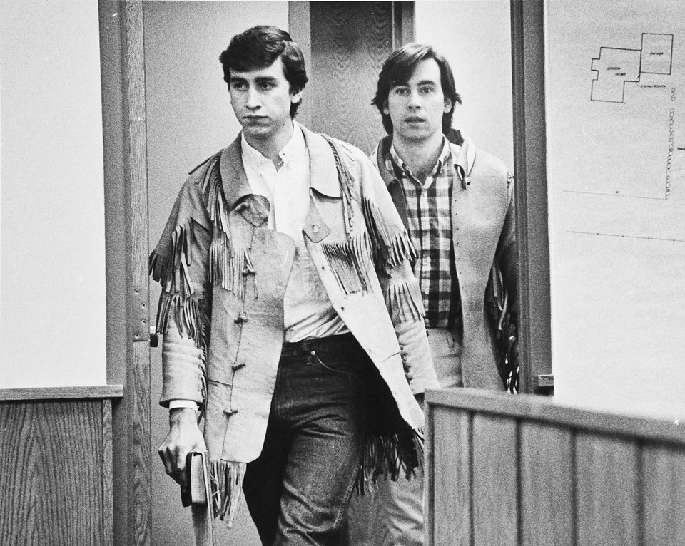 Photo - FILE - This undated file photo shows  Jonathan Swapp, left, and Addam Swapp, right, enter a Coalville, Utah courtroom.  Swapp, the man who bombed a Mormon church building and sparked a 13-day standoff in 1988 that left a corrections officer dead at a polygamist compound, was released from prison on Tuesday, July 9, 2013,  after more than 25 years behind bars.  Swapp, 52, was accompanied by family members as he left Sanpete County Jail three months after members of the state board of pardons and parole approved his release, saying he had shown remorse for leading the standoff in Marion.  (AP Photo/The Salt Lake Tribune, Lynn R. Johnson, file)