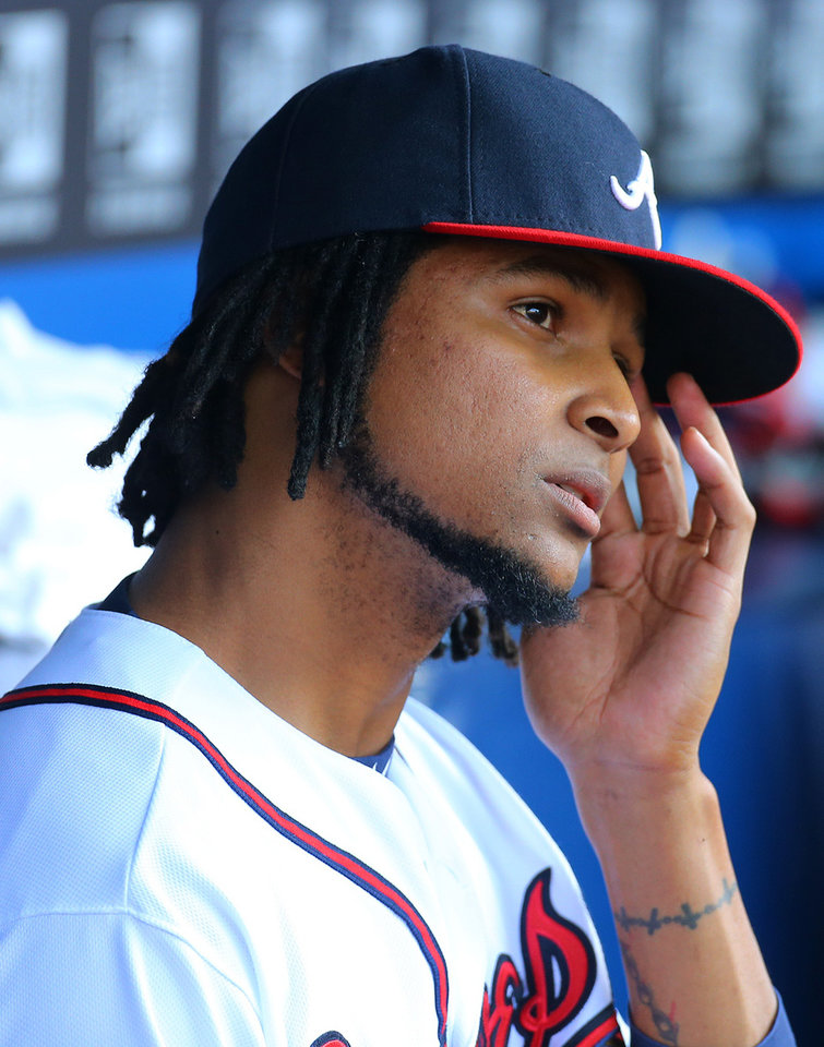 Photo - Atlanta Braves pitcher Ervin Santana sits in the dugout after giving up a grand slam to the Milwaukee Brewers Mark Reynolds during the first inning of a baseball game on Wednesday, May 21, 2014, in Atlanta.  (AP Photo/Atlanta Journal-Constitution, Curtis Compton)  MARIETTA DAILY OUT; GWINNETT DAILY POST OUT; LOCAL TV OUT; WXIA-TV OUT; WGCL-TV OUT