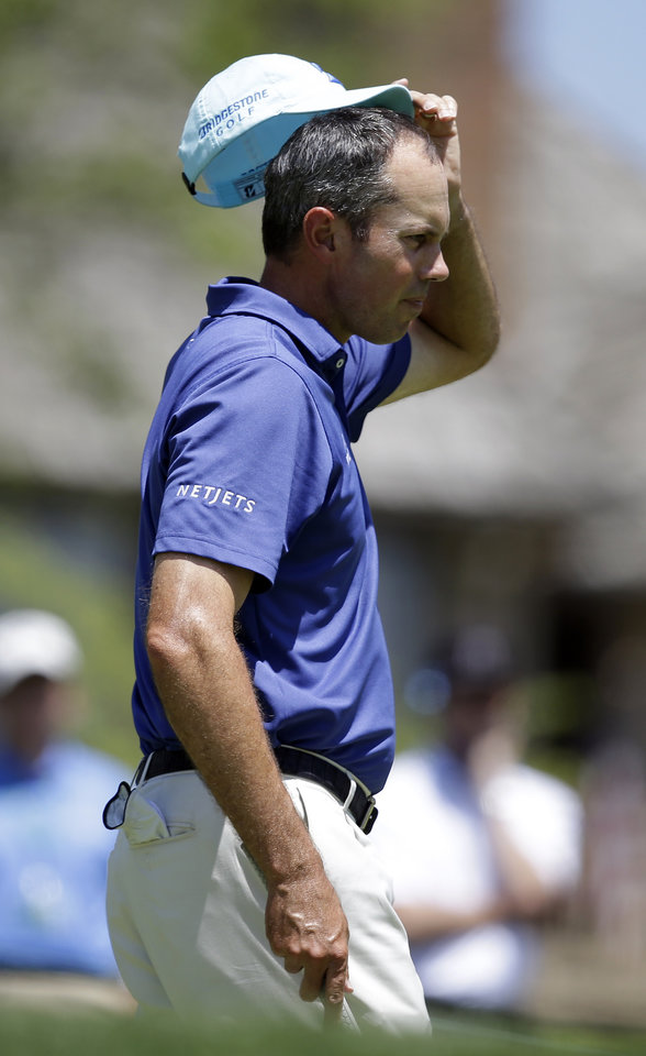 Photo - Matt Kuchar waits to hit on the fourth green during the second round of the Memorial golf tournament Friday, May 30, 2014, in Dublin, Ohio. (AP Photo/Darron Cummings)