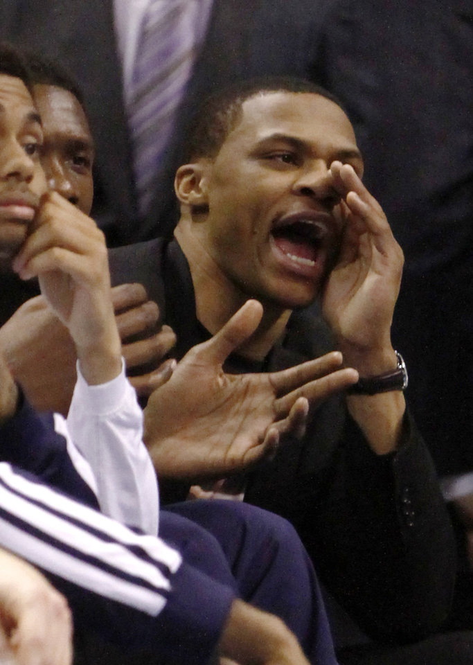 Photo - Oklahoma City Thunder guard Russell Westbrook reacts to a call against the Thunder during the second quarter of an NBA basketball game against the Golden State Warriors on Friday, Jan. 17, 2014, in Oklahoma City. (AP Photo/Alonzo Adams)