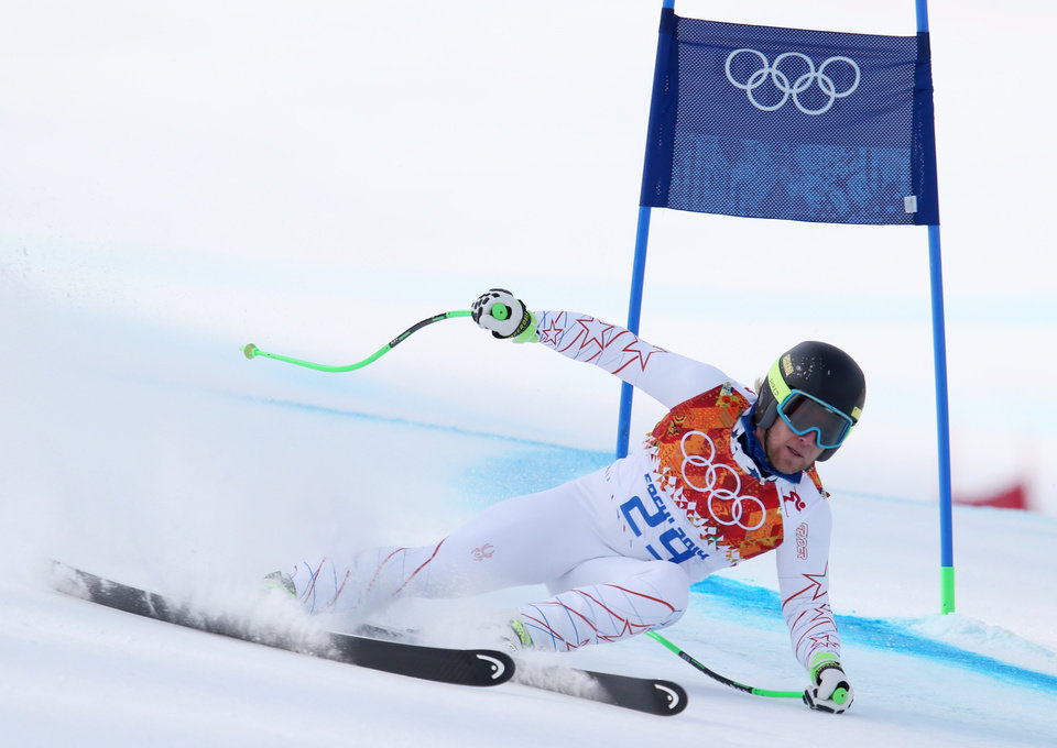 Photo - United States' Andrew Weibrecht passes a gate in the men's super-G at the Sochi 2014 Winter Olympics, Sunday, Feb. 16, 2014, in Krasnaya Polyana, Russia. (AP Photo/Alessandro Trovati)