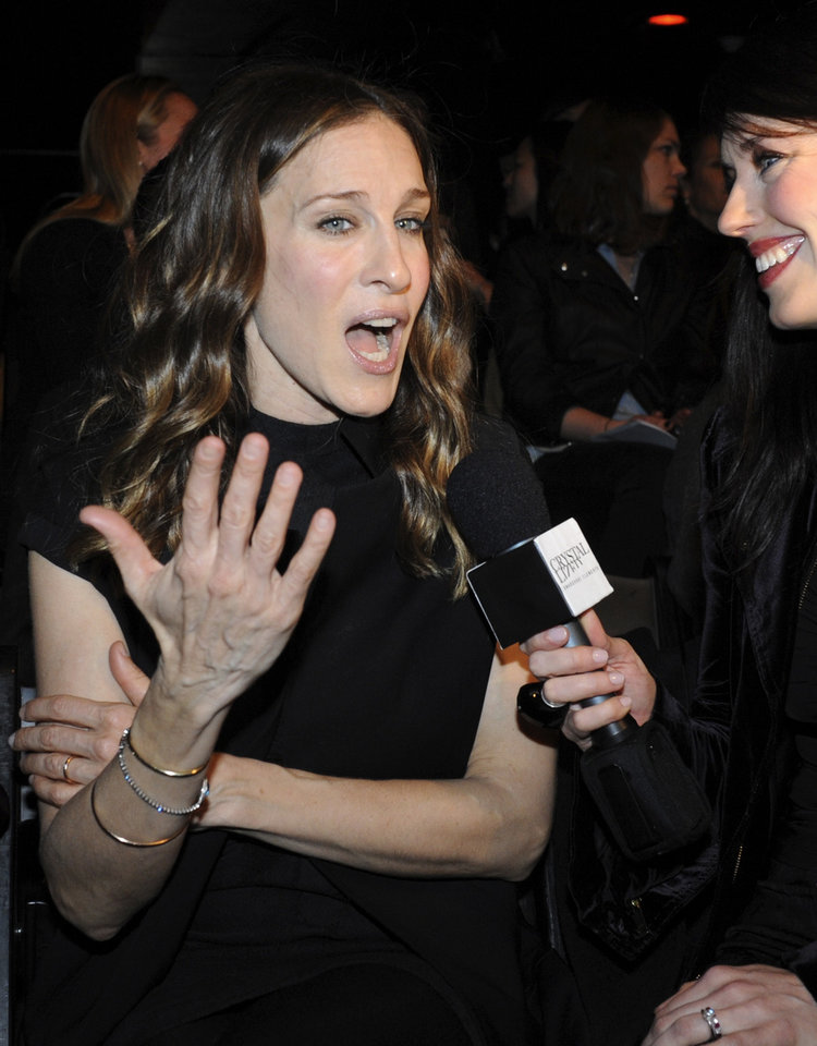 Sarah Jessica Parker is interviewed on the runway before the showing of the fall 2009 collection of Alexander Wang during Fashion Week, Saturday, Feb. 14, 2009, in New York. (AP Photo/ Louis Lanzano)