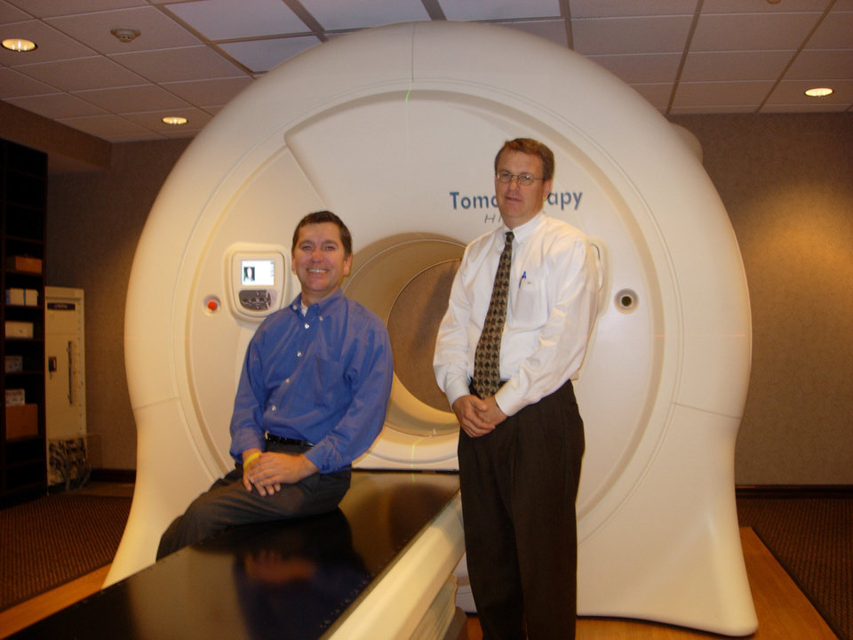Jim Eastep and his Radiologist Dr. John Taylor beside the Deaconess TomoTherapy machine. Community Photo By: L. Buford Submitted By: Leslie, oklahoma city