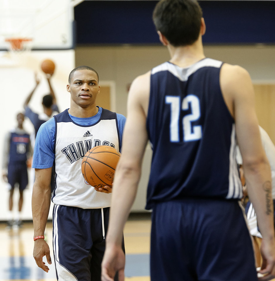 Photo - Russell Westbrook speaks with Steven Adams while working in team practice during the Oklahoma City Thunder media availability at the Thunder practice facility in Oklahoma City, Okla. on Monday, May 12, 2014.   Photo by Chris Landsberger, The Oklahoman