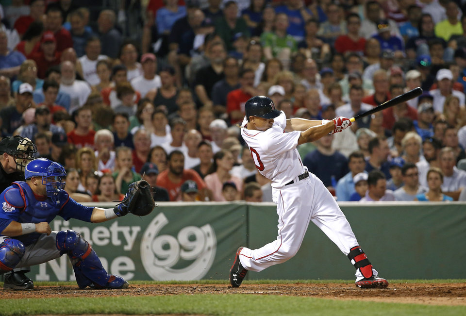 Photo - Boston Red Sox's Mookie Betts, right, hits a two-run home run in the fifth inning of a baseball game against the Chicago Cubs at Fenway Park in Boston, Wednesday, July 2, 2014. (AP Photo/Elise Amendola)