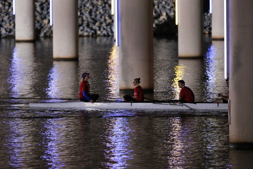 A rowing team rows down the Oklahoma River during the Oklahoma Regatta Festival Night Sprints in Oklahoma City, Thursday, Sept. 27, 2012. Photo by Garett Fisbeck, The Oklahoman