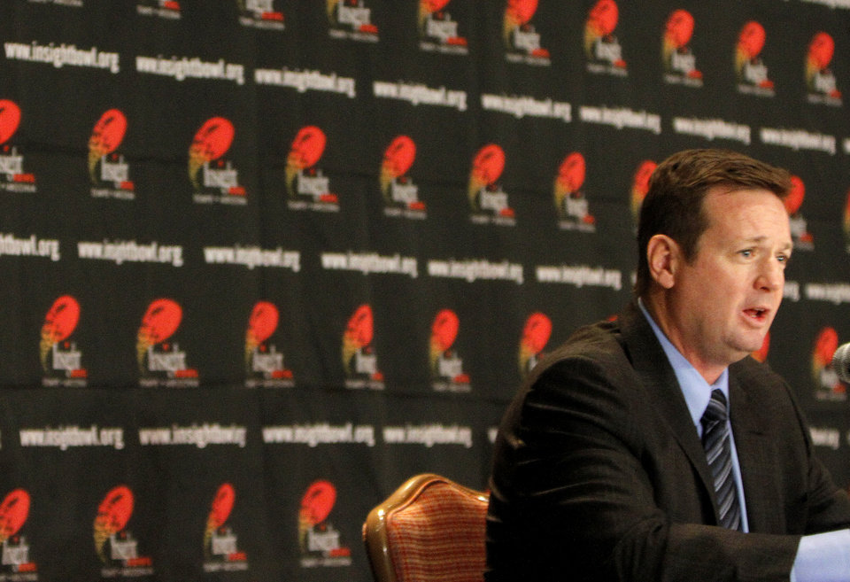 Photo - Oklahoma head coach Bob Stoops speaks to the media during a press conference for the Insight Bowl at the Camelback Inn in Paradise Valley, Ariz.,  Thursday, Dec. 29, 2011. Photo by Sarah Phipps, The Oklahoman