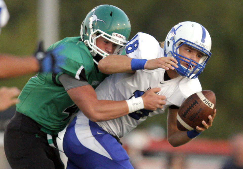 Photo - Jones'  Tyler Weese sacks Hennessey's Trey Leu during the high school football game between Jones and Hennessey  Friday, Sept. 9, 2011. Photo by Sarah Phipps, The Oklahoman