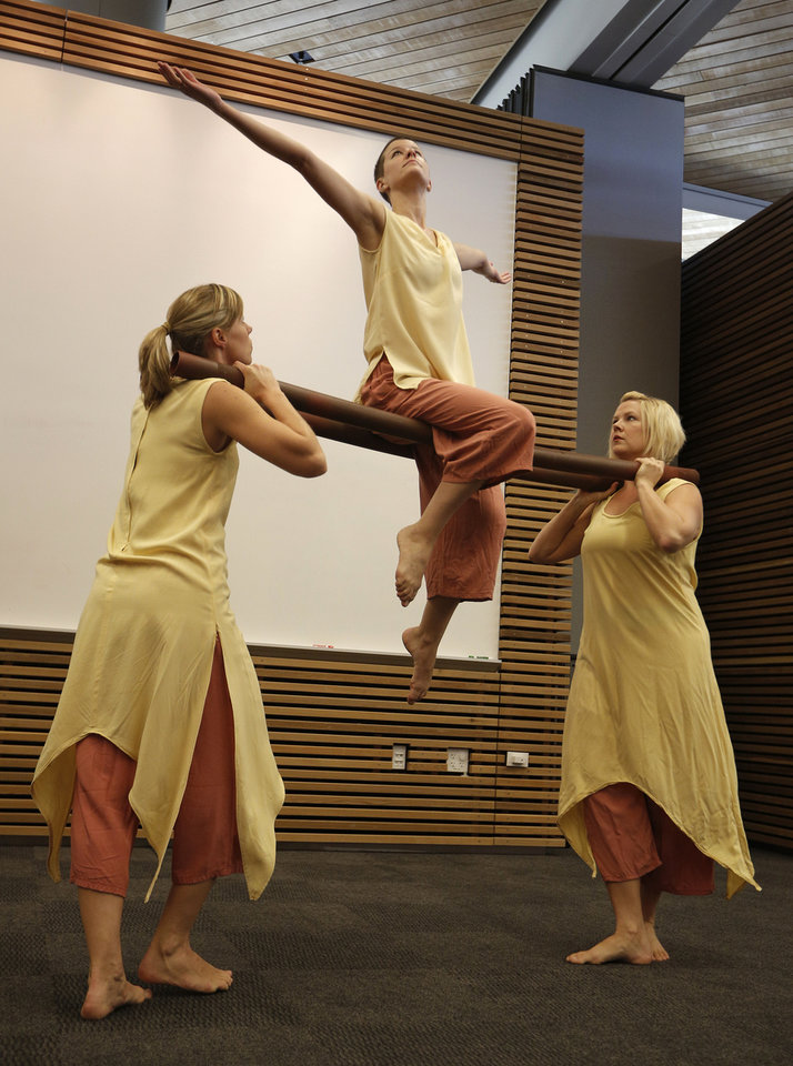 Amy Nevius, Emily Dawson and Michelle Moeller, with Perpetual Motion dance company, perform at the  Patience S. Latting Northwest Library in Oklahoma City.  Photo by Garett Fisbeck, The Oklahoman <strong>Garett Fisbeck - Garett Fisbeck</strong>