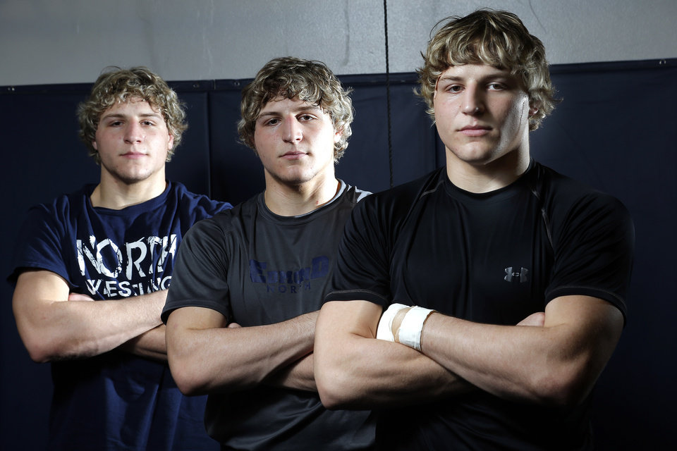 Photo - From left to right Edmond North wrestlers , Lance, Joel and Andrew Dixon poses for a picture at Edmond North High School in Edmond, Okla.,  Thursday, Feb. 7, 2013.Photo by Sarah Phipps, The Oklahoman