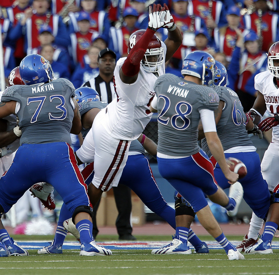 OU's Jordan Wade (93) blocks the extra point kick of KU's Matthew Wyman (28) in the fourth quarter during of the college football game between the University of Oklahoma Sooners (OU) and the University of Kansas Jayhawks (KU) at Memorial Stadium in Lawrence, Kan., Saturday, Oct. 19, 2013. OU won 34-19. Photo by Sarah Phipps, The Oklahoman