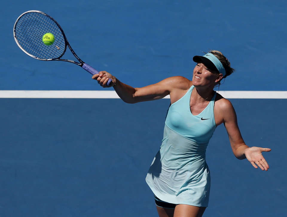 Photo - Maria Sharapova of Russia hits a forehand return to Karin Knapp of Italy during their second round match at the Australian Open tennis championship in Melbourne, Australia, Thursday, Jan. 16, 2014.(AP Photo/Aaron Favila)