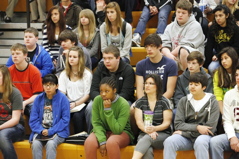 Photo - boldStudents listen to Cassandra Oakes, who visited Western Oaks Middle School in Bethany to provide a motivational message before standardized tests are given.