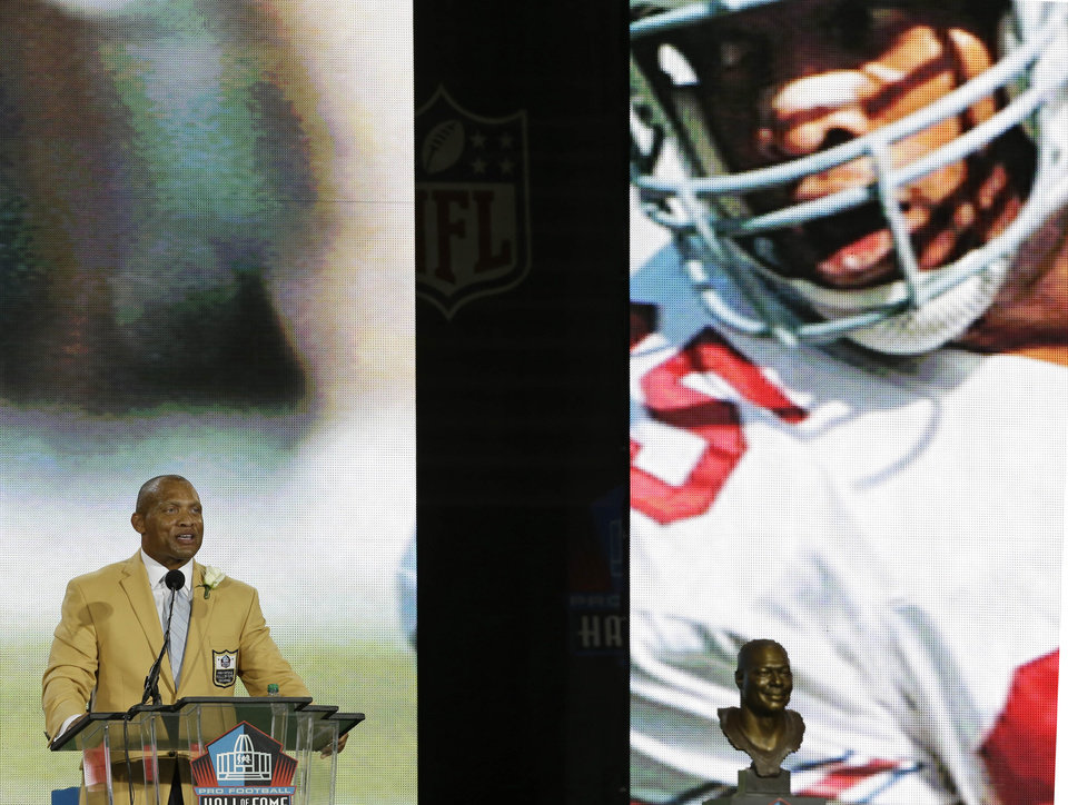 Photo - Hall of Fame inductee Aeneas Williams speaks during the Pro Football Hall of Fame enshrinement ceremony Saturday, Aug. 2, 2014, in Canton, Ohio. (AP Photo/Tony Dejak)