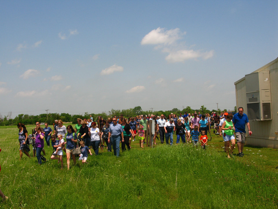 Photo - Members of the Acts II United Methodist Church congregation walk out to the site where the church's new building will be constructed. Photo provided