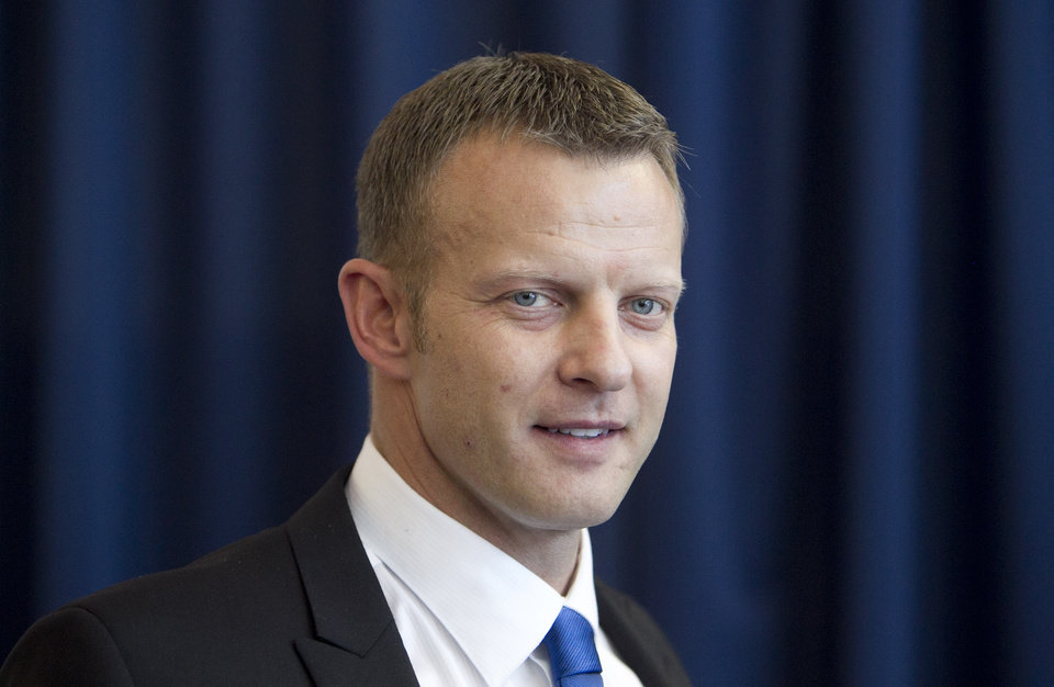 Photo - Boise State's new head coach Bryan Harsin smiles as he addresses a crowd of supporters and media during his introduction at an NCAA college football news Conference Friday, Dec. 13, 2013, in Boise, Idaho. (AP Photo/The Idaho Statesman, Kyle Green) MANDITORY CREDIT; LOCAL TV OUT